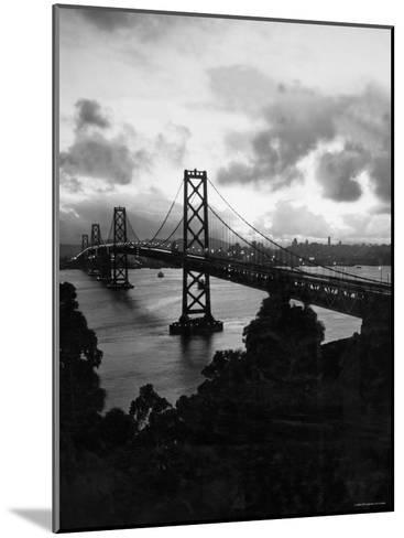 Atmospheric View of the San Francisco Oakland Bay Bridge Viewed from the Oakland Side at Dusk--Mounted Photographic Print