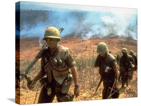 Line of Soldiers Marching Up Hill with Smoky Fires in Background, During Route 9 Offensive-Larry Burrows-Stretched Canvas Print