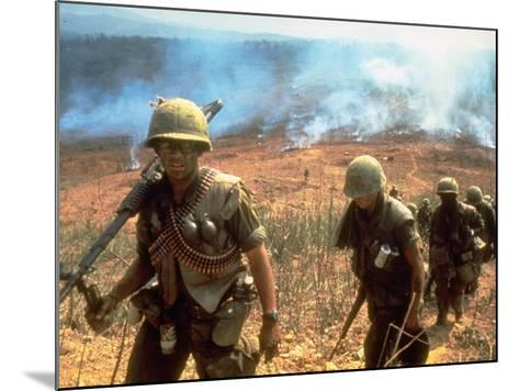 Line of Soldiers Marching Up Hill with Smoky Fires in Background, During Route 9 Offensive-Larry Burrows-Mounted Photographic Print