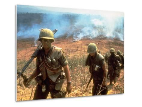 Line of Soldiers Marching Up Hill with Smoky Fires in Background, During Route 9 Offensive-Larry Burrows-Metal Print