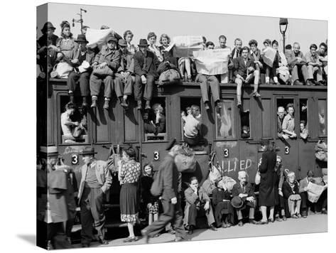 Civilians Packing Onto Overcrowded Train Leaving Postwar Berlin-Margaret Bourke-White-Stretched Canvas Print