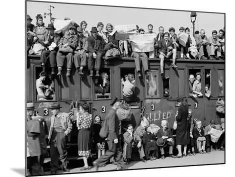 Civilians Packing Onto Overcrowded Train Leaving Postwar Berlin-Margaret Bourke-White-Mounted Photographic Print