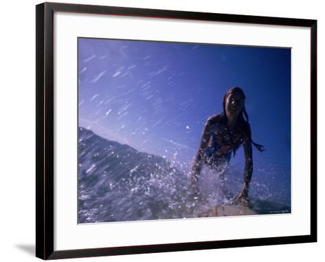 Low Angle View of a Teenage Girl Riding a Surfboard-George Silk-Framed Art Print