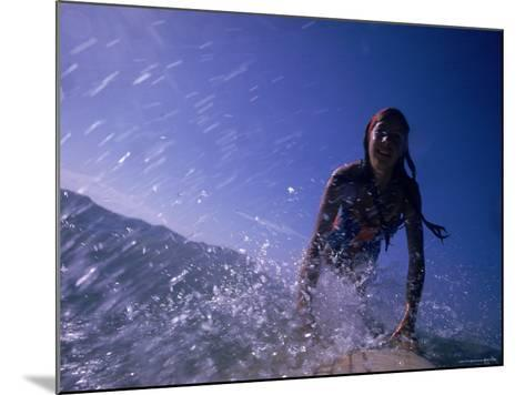 Low Angle View of a Teenage Girl Riding a Surfboard-George Silk-Mounted Photographic Print
