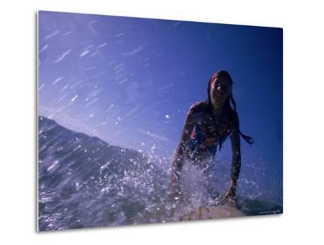 Low Angle View of a Teenage Girl Riding a Surfboard-George Silk-Metal Print