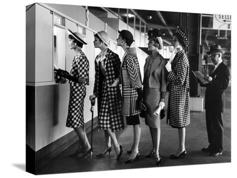 5 Models Wearing Fashionable Dress Suits at a Race Track Betting Window, at Roosevelt Raceway-Nina Leen-Stretched Canvas Print
