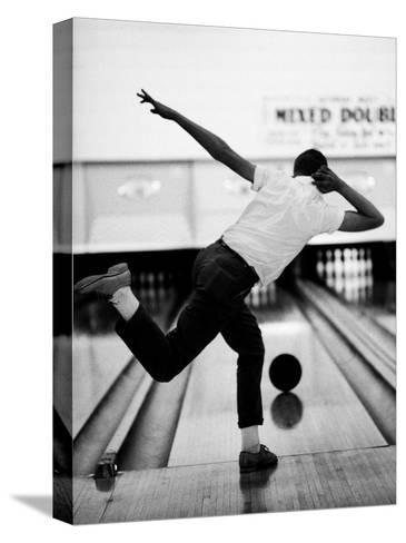 Boy Bowling at a Local Bowling Alley-Art Rickerby-Stretched Canvas Print