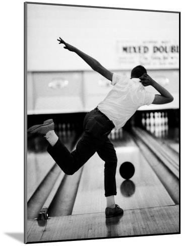 Boy Bowling at a Local Bowling Alley-Art Rickerby-Mounted Photographic Print