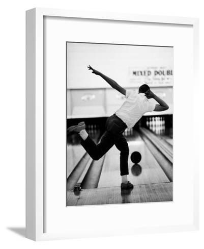 Boy Bowling at a Local Bowling Alley-Art Rickerby-Framed Art Print