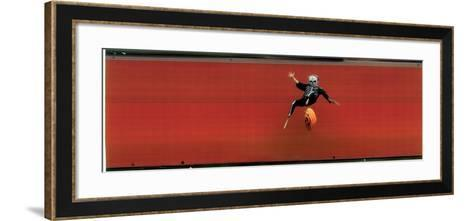 Child in Halloween Skeleton Costume Jumping in Air-George Silk-Framed Art Print