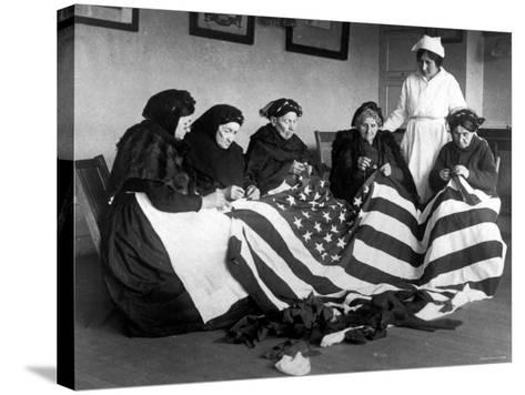 Patriotic Old Female Immigrants Sewing an American Flag under Supervision of Instructor Rose Radin--Stretched Canvas Print