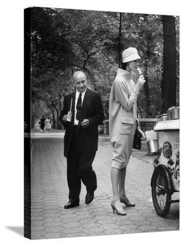 "Woman Wearing Copy of Givenchy's Beige Jersey ""Bag"" Dress and Cloche Like Hat-Yale Joel-Stretched Canvas Print"