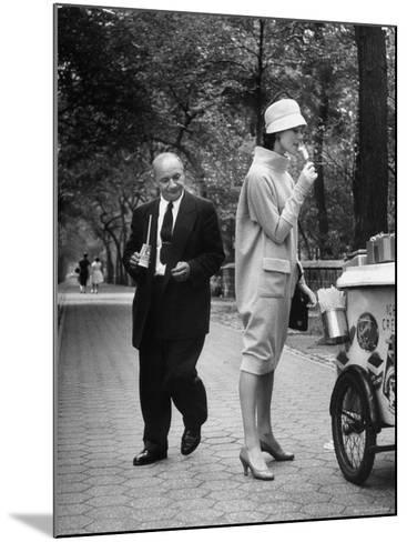"Woman Wearing Copy of Givenchy's Beige Jersey ""Bag"" Dress and Cloche Like Hat-Yale Joel-Mounted Photographic Print"