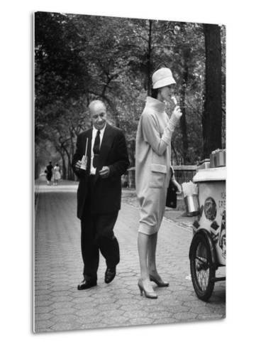 "Woman Wearing Copy of Givenchy's Beige Jersey ""Bag"" Dress and Cloche Like Hat-Yale Joel-Metal Print"
