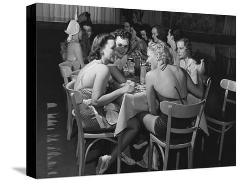 Fashion Models Taking Their Lunch Break at the Racquet Club Cafe-Peter Stackpole-Stretched Canvas Print