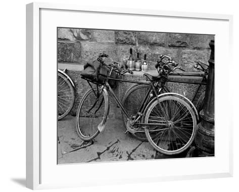 Bicycles Leaning Against the Concrete Wall-Carl Mydans-Framed Art Print