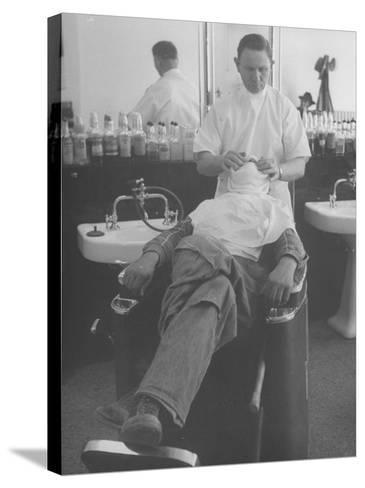 Man Receiving a Shave in a Barber Shop-Cornell Capa-Stretched Canvas Print