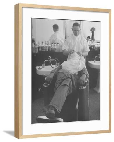 Man Receiving a Shave in a Barber Shop-Cornell Capa-Framed Art Print