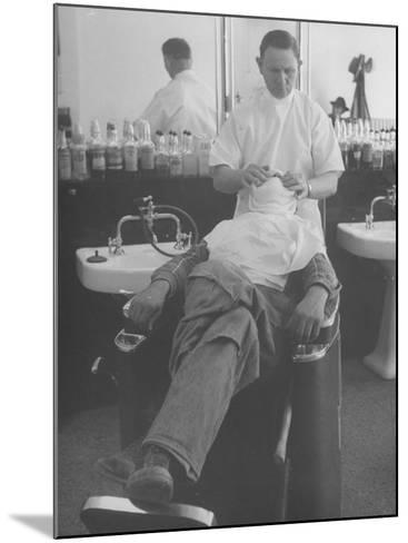 Man Receiving a Shave in a Barber Shop-Cornell Capa-Mounted Photographic Print