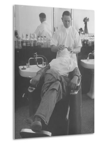 Man Receiving a Shave in a Barber Shop-Cornell Capa-Metal Print