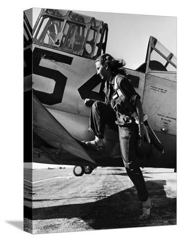 Female Pilot of the Us Women's Air Force Service Posed with Her Leg Up on the Wing of an Airplane-Peter Stackpole-Stretched Canvas Print