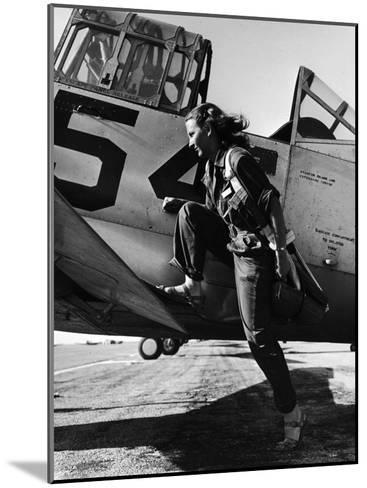 Female Pilot of the Us Women's Air Force Service Posed with Her Leg Up on the Wing of an Airplane-Peter Stackpole-Mounted Photographic Print