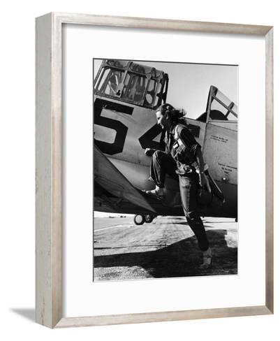 Female Pilot of the Us Women's Air Force Service Posed with Her Leg Up on the Wing of an Airplane-Peter Stackpole-Framed Art Print
