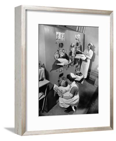 Nurses at Children's Hospital Tending Young Polio Patients Contained in Iron Lung Room-Hansel Mieth-Framed Art Print