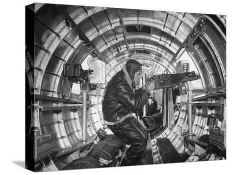 Crewman Poking His 50 Cal. Machine Gun Out of Side Window of B-17E Flying Fortress During WWII-Frank Scherschel-Stretched Canvas Print