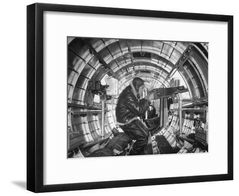 Crewman Poking His 50 Cal. Machine Gun Out of Side Window of B-17E Flying Fortress During WWII-Frank Scherschel-Framed Art Print