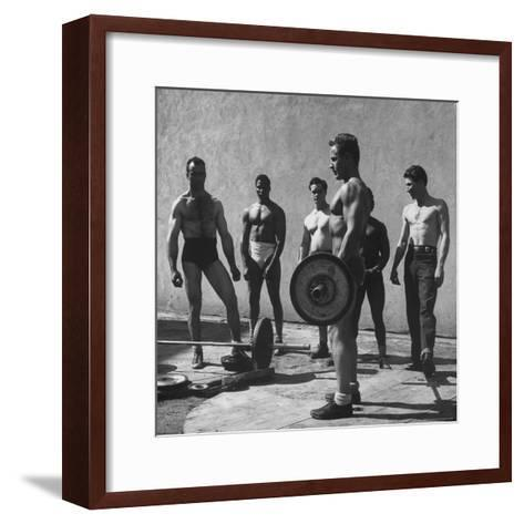 Prisoners at San Quentin Weightlifting in Prison Yard During Recreation Period-Charles E^ Steinheimer-Framed Art Print