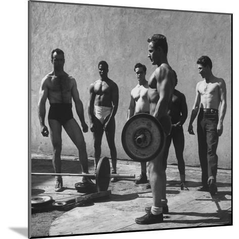 Prisoners at San Quentin Weightlifting in Prison Yard During Recreation Period-Charles E^ Steinheimer-Mounted Photographic Print
