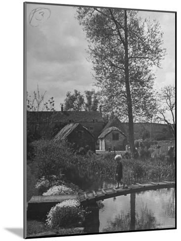Little Boy Crossing the Bridge over the Stream at Winson Mill Farm, A War Nursery-Hans Wild-Mounted Photographic Print