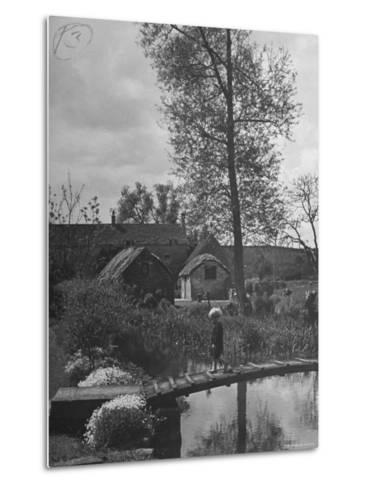 Little Boy Crossing the Bridge over the Stream at Winson Mill Farm, A War Nursery-Hans Wild-Metal Print