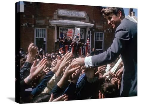 Democratic Presidential Contender Bobby Kennedy Shaking Hands in Crowd During Campaign Event-Bill Eppridge-Stretched Canvas Print