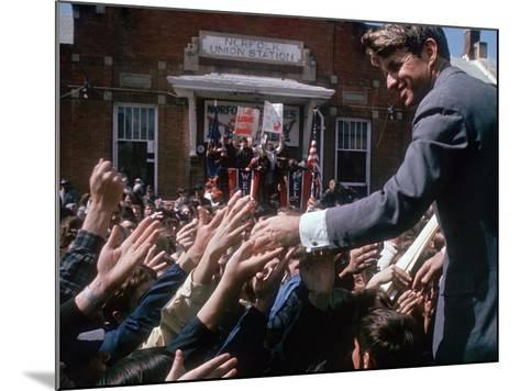 Democratic Presidential Contender Bobby Kennedy Shaking Hands in Crowd During Campaign Event-Bill Eppridge-Mounted Photographic Print