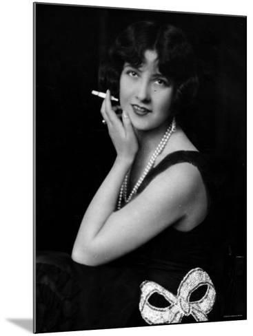 Fashionable Woman with Cigarette Holder in Hand Wearing Long Double Strand Pearl Necklace--Mounted Photographic Print