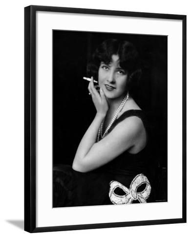 Fashionable Woman with Cigarette Holder in Hand Wearing Long Double Strand Pearl Necklace--Framed Art Print