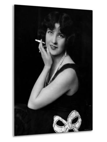 Fashionable Woman with Cigarette Holder in Hand Wearing Long Double Strand Pearl Necklace--Metal Print