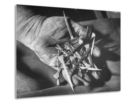 Man Holding Nails That Have Been Pulled from Old Horseshoes-Fritz Goro-Metal Print