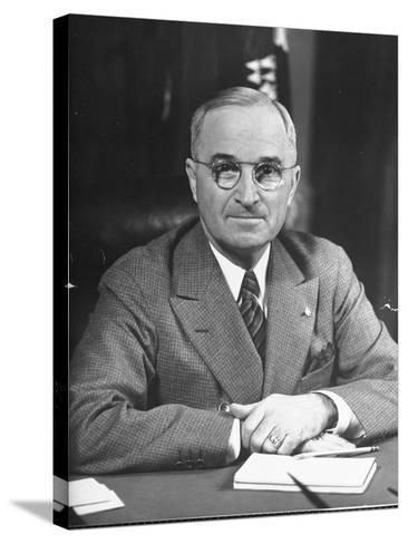 Harry S. Truman Sitting at Desk-Marie Hansen-Stretched Canvas Print