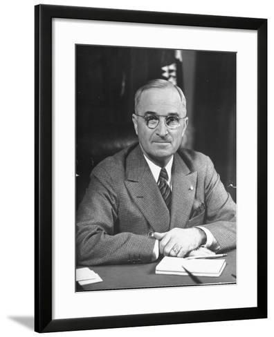 Harry S. Truman Sitting at Desk-Marie Hansen-Framed Art Print