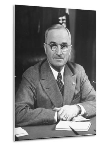 Harry S. Truman Sitting at Desk-Marie Hansen-Metal Print