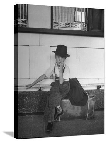 Little Boy Sitting on His Luggage While Waiting For the Train at the Denver Union Station-Sam Shere-Stretched Canvas Print