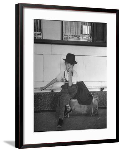 Little Boy Sitting on His Luggage While Waiting For the Train at the Denver Union Station-Sam Shere-Framed Art Print