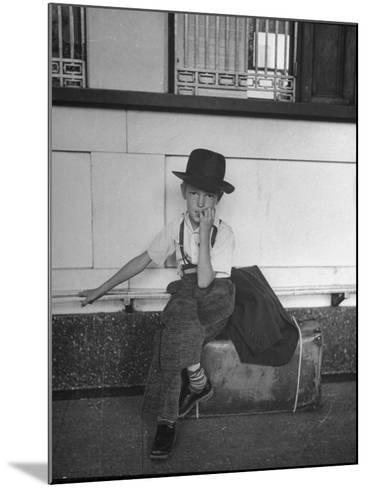 Little Boy Sitting on His Luggage While Waiting For the Train at the Denver Union Station-Sam Shere-Mounted Photographic Print