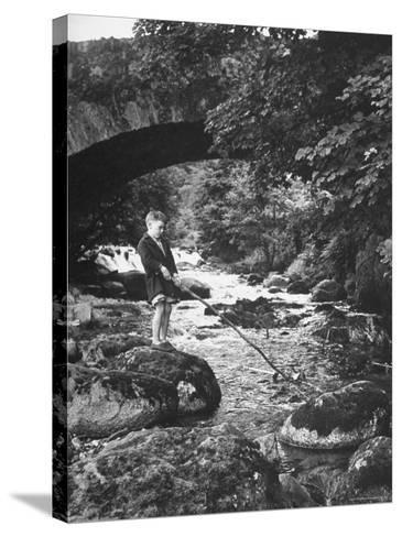 Boy Fishing by the Bridge over the Laroch in Ballachulish-Hans Wild-Stretched Canvas Print