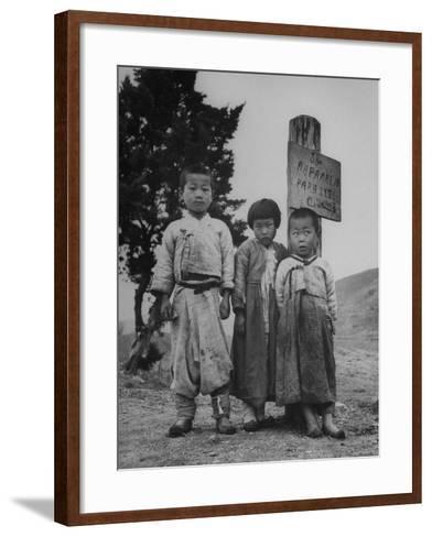 Children Standing in Front of Boundary Zone Sign Written in Russian, English, and Korean-John Florea-Framed Art Print