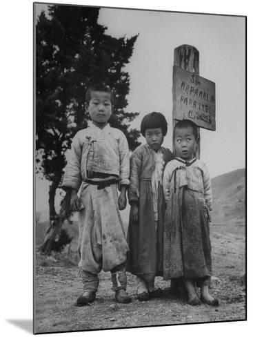 Children Standing in Front of Boundary Zone Sign Written in Russian, English, and Korean-John Florea-Mounted Photographic Print