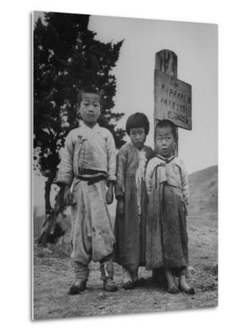 Children Standing in Front of Boundary Zone Sign Written in Russian, English, and Korean-John Florea-Metal Print